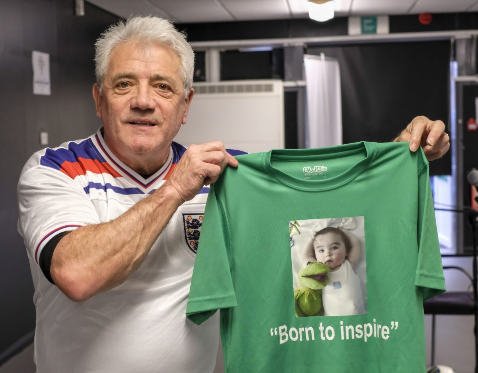 "Dated: 03/03/17 Kevin Keegan joins athletes from the Special Olympics Northern region team who have recorded the song This Time, We'll Get it Right which will be played as they enter Sheffield United's Bramall Lane stadium for the opening ceremony. The song was originally written and recorded for England's 1982 World Cup campaign, in which Keegan was a player, and has been adapted to become the Northern Region's anthem. This picture shows Kevin with a ""Born to Inspire"" tee shirt.      #NorthNewsAndPictures/2daymedia"